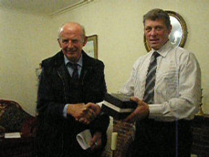 Photos of David Jane and George Knox receiving their awards from Chairman John Smithson