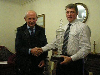 Photo of David Jane receiving the Rouge Sheep Society Show Flock Award from Chairman John Smithson