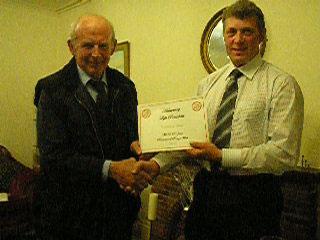 Photo of David Jane receiving his award from Chairman John Smithson.