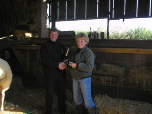 John Smithson receiving the sheep judging prize from Sue Wilkinson